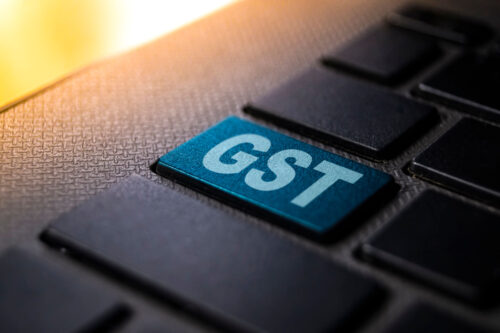 Why do I have to pay GST for expenses because I already pay income tax?